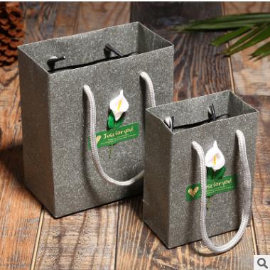 供应 热销服装化妆礼品手提袋 创意贴花纸袋包装袋 厂家包装定制批发